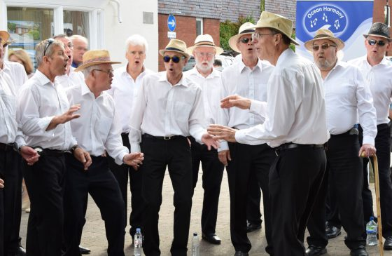 Ocean Harmony singing in Hythe in the sun..