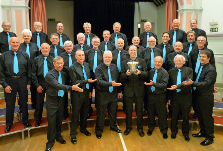Ocean Harmony in one of their performance costumers; black shirts and turquoise ties