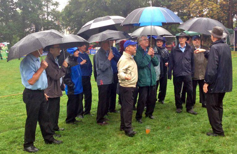 Ocean Harmony singing in the rain at Ashurst Fete